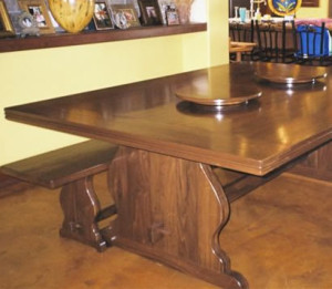 Walnut trestle table with 2 lazy susans built in.