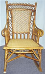 Antique Heywood Wakefield Rocker, ornate design, natural color