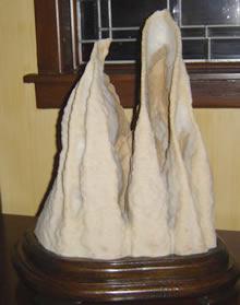 Above: Suiseki (water stone) with daiza
